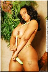 Stephanie The Ice Cold Champagne's ebony body In Yellow Sling: Image 9